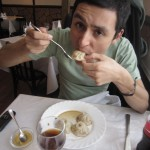 David's dining partner attempts to eat the elusive pozi.