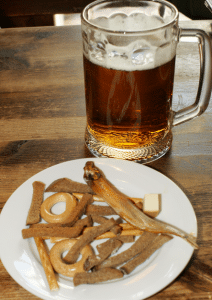 Beer snacks at the Tolstiy Friar mean fried rye and smoked fish, not cheese sticks and wings.
