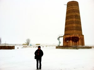 The author in front of Burana Tower in Tokmok, Kyrgyzstan. Tokmok has a sizeable Chechen population.