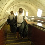National Opera of Ukraine ballet company dancers with their tutu bags, heading home via the metro