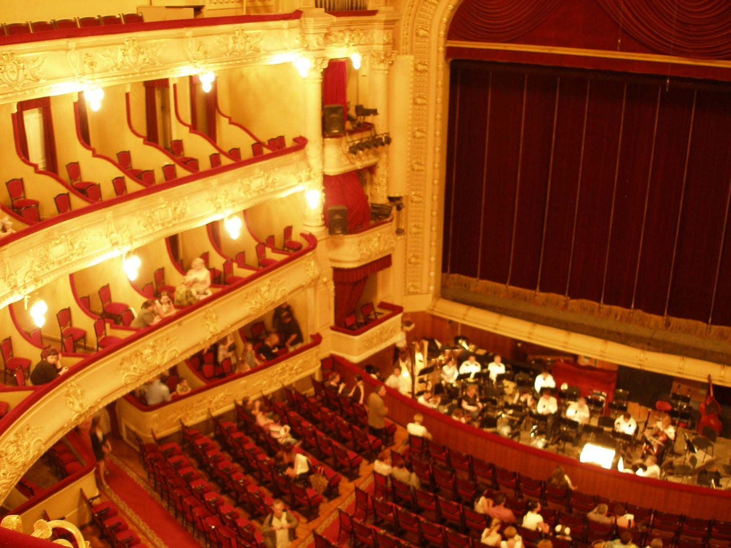 View from one of the theater balconies before a ballet production. Not many audience members had arrived yet, but the orchestra musicians were already warming up.