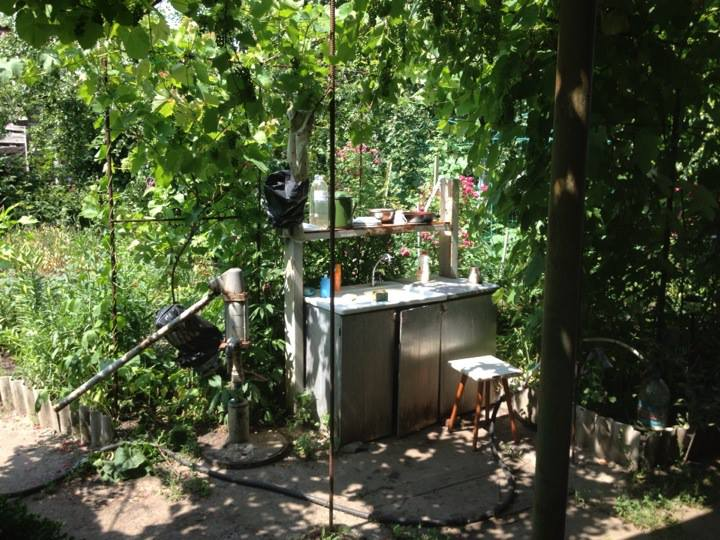 The outdoor kitchen at the dacha, perfect for preparing a summer lunch