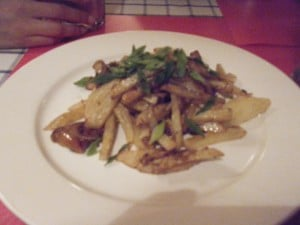 Hot potatoes and mushrooms. Very delicious! (Very Russian...)
