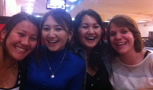 The author, on the far right, is pictured with some of the many cousins she has met. In this photo, she is teaching the Kazakh girls how to smile like Americans!