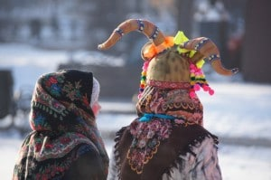 Traditional costumes on display on Kirov Square in winter.