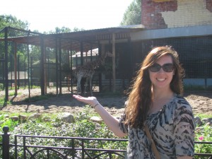 In front of the giraffe enclosure