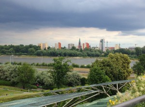 From the library's green roof, one can see across the river to Praga and the solar panels surrounding the building