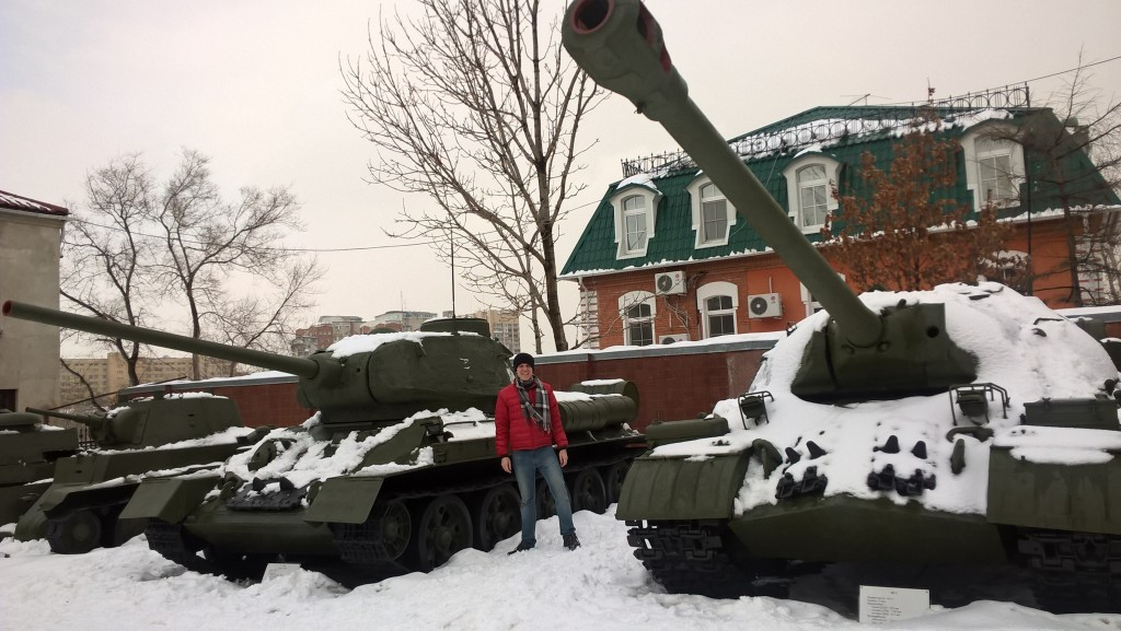 Standing beside a Soviet T34-85 tank from World War II.