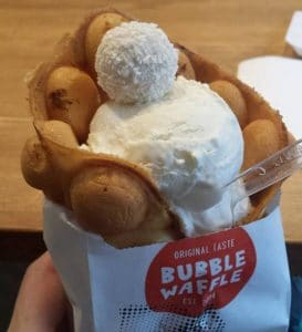 A vanilla waffle with apples, cinnamon, and ice cream at Bubble Waffle.
