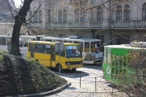 Some of Lviv's public transport: a marshrutka and two trams.