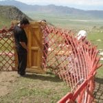 """3. A small door, """"eshik"""" in Kyrgyz, completes the yurt base structure."""