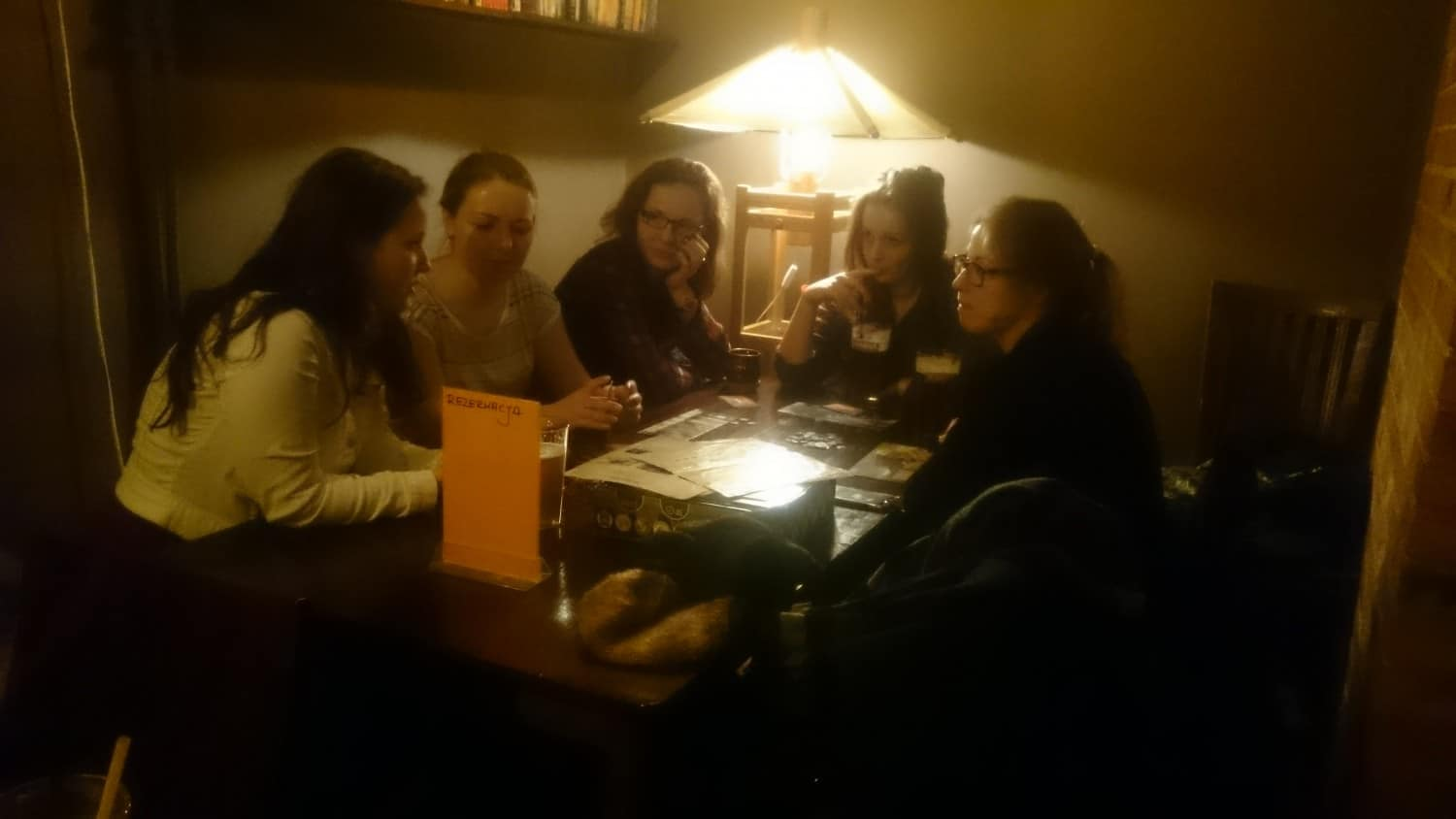 "The author learning from four Polish girls how to play ""Seven Wonders"""